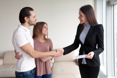 couple making a deal with real estate agent